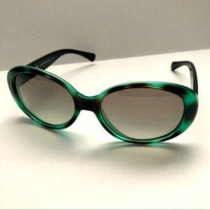 Green and black Coach sunglasses